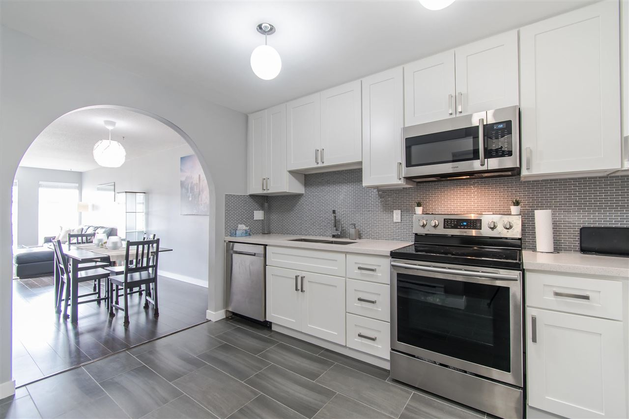 Welcome home to this newly renovated top floor home with mountain views at the Benton. 2 large bedrooms, 2 full baths, spacious entry + extra in-suite storage. High-quality modern updates throughout, an open floorplan, and great overall design make this unit really stand out. In-suite laundry. 1 parking stall + 1 storage locker included. 2 Pets allowed (no size restrictions). 3 rentals allowed (currently at max). Newer roof. Half a block walk to McLean Park, walking distance to Save on Foods, Shops, Pubs & Restaurants on Prairie + Coast Meridian. Short distance to Costco, Walmart, and Fremont Village. Easy access to transit. Showings by appointment, easy to view.