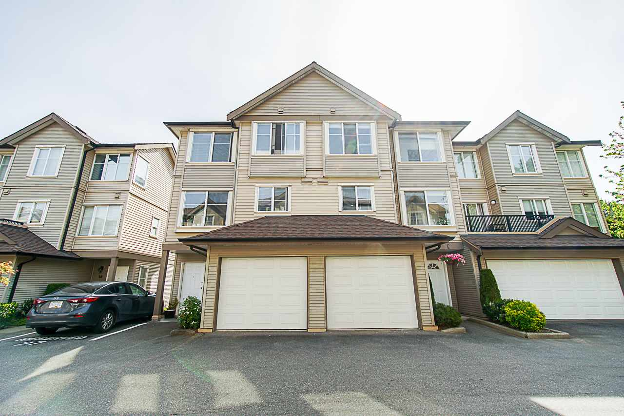 Completely Renovated in 2017-2018, Absolutely stunning. Professionally finished by Woodridge Finishing Ltd, with the highest quality. Over $77,000 spent. 3 Levels, 3 Bedrooms Up, 2 Full bathrooms, Open Concept Main Floor, Kitchen with Nickels Cabinets supplied by Genesis Kitchen, Huge Island with Quartz Counters, B/I Recycle, large pantry with pull out drawers, Beverage Centre, New York Style back splash, Under Counter Lighting, Updated Electrical, 14 Pot Lights with LED on dimmers, Smooth Ceilings on main, Stainless Steel appl's with Samsung induction stove, fridge with ice/water, Bosch dishwasher, Wine/Beer Fridge, Laminate fl throughout, Cultural Stone gas f/p, all upgraded full bathrooms. Extra's upgrades, paint, hardware on doors, baseboards, moldings, gas outlet in back, Patio 225 sq ft, Balcony 85 sq ft., Garage 11'5 x 18'7 and 1 Open parking. A must see. Pets allowed. Super Central Location, Coquitlam Centre, K - 5 Central Community Elem, 6 - 8 École Pitt River Middle, K - 5 École Mary Hill Elementa