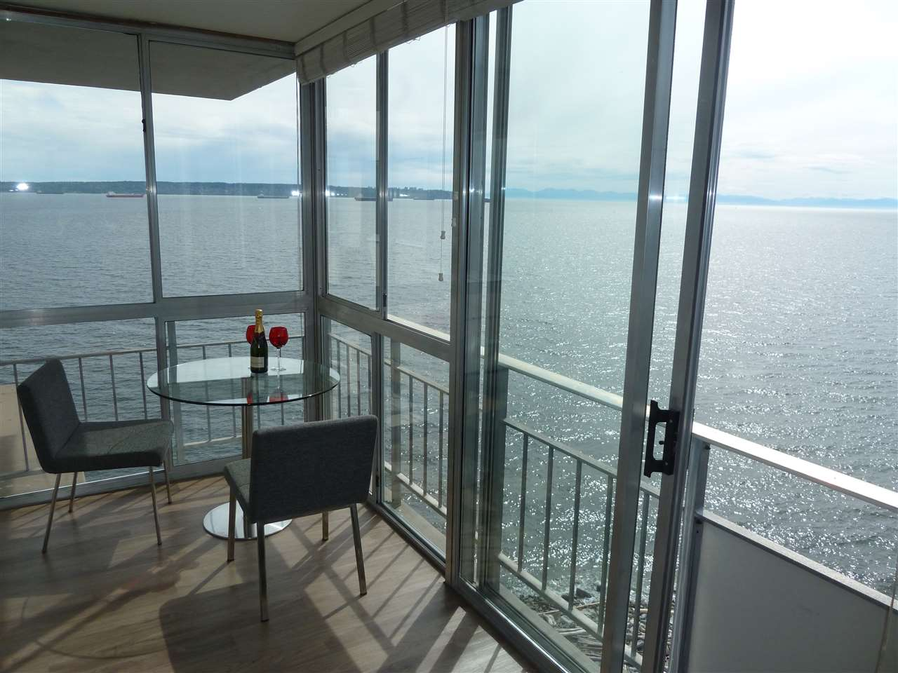 """Outstanding """"Seastrand"""" gem awaits you! This northwest corner unit has outstanding waterfront ocean views over Dundarave pier and West Van Seawall, and the view continues to Dundarave Village and extends to the North Shore mountains. Very bright and open - don't be fooled by square footage. Immaculate condition with milled hardwood floors, large open kitchen, and enclosed balcony with windows that open to allow the cool ocean breeze in on those hot summer days. Five star location just steps to Seawall, and a short walk to restaurants, grocery, and specialty stores, and all types of amenities. Rentals allowed as well as 1 cat. Catchment area for exclusive Irwin Park Elementary."""