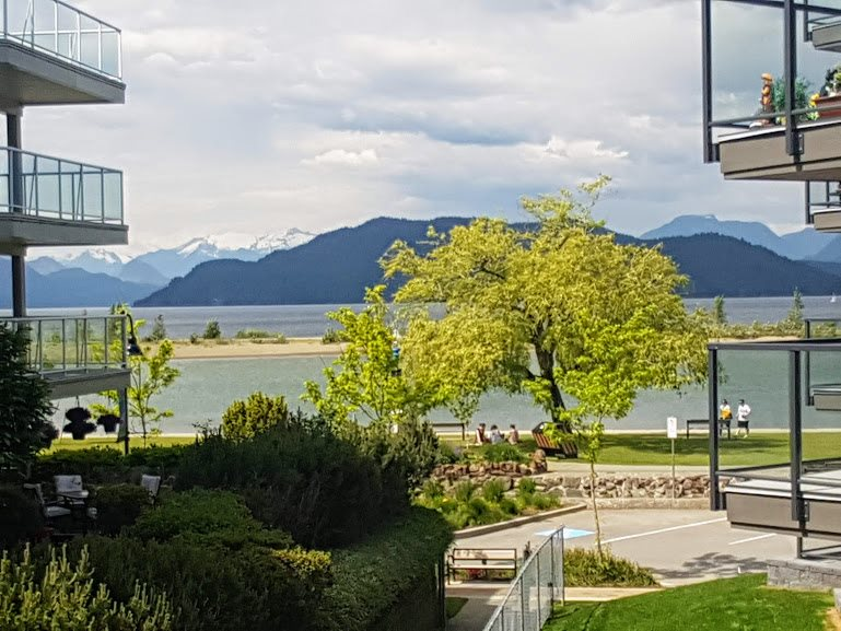 WATERFRONT CONDO in Harrison Hot Springs premier private residences building on the beach and in the heart of the Village. Bright corner unit, 1,083 sq ft comfortable living space with 2 bedrms plus den, 2 full bathrms including master with walk in closet and ensuite, well appointed kitchen open to Living room with sliding doors to a large covered sundeck. AMAZING VIEWS of the lake to the North and the river and mountains to the south.  OVER 5 MILLION spent to fully retrofit the exterior of the building with cement board, brick and metal with rainscreen installation plus roof and sundeck upgrades and all new landscaping! Enjoy the spa room, guest suite and underground parking at the Beach. Get value for your lifestyle purchase right here and enjoy the peace and quiet and the view.
