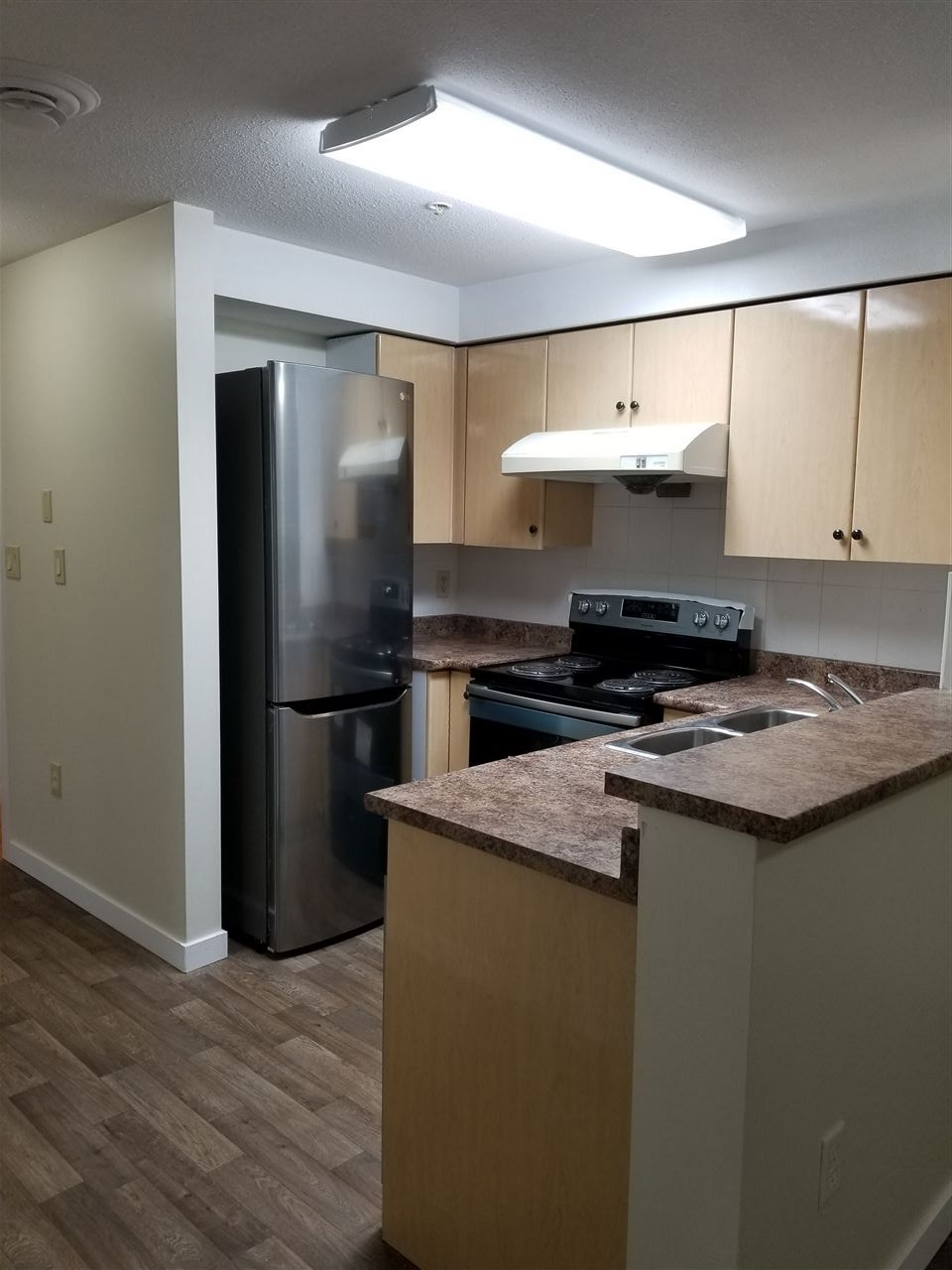 Totally renovated unit with all new appliances, kitchen cabinets, all new floors. Open layout. Concrete building with low strata fees. Great location. shopping, doctors, bank, school, transportation. On route to Scott Road Skytrain. Great investment. All measurements and square footage must be verified.