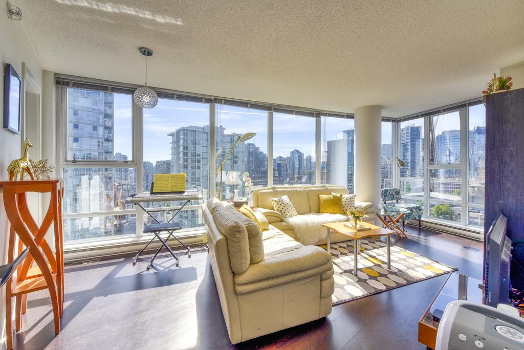 *****OPEN HOUSE: June 15th 2:00-4:00***** Spectrum 4 built by Concord Pacific. Bright corner unit with 899 sq.ft living space, 2 Bed, 2 Full Bath, 1 Den, and 1 insuite Storage. Absolutely amazing views! 270 degrees of North Shore Mountain, Ocean, and City view. Gourmet kitchen with granite countertops, built-in wine rack/microwave, and S/S appliances. Open floor plan with floor to ceiling windows. Laminated floors  throughout the living & dining area. Deluxe amenities include 24 hrs Concierge service, Lounge, 80 ft pool, Whirl Pool, Sauna, Steam Room, Exercise Room, and Meeting Room. In heart of downtown steps away from Stadium skytrain station, BC Place, Rogers Arena, Costco, T&T Supermarket, shopping, and restaurants. 1 parking stall included.