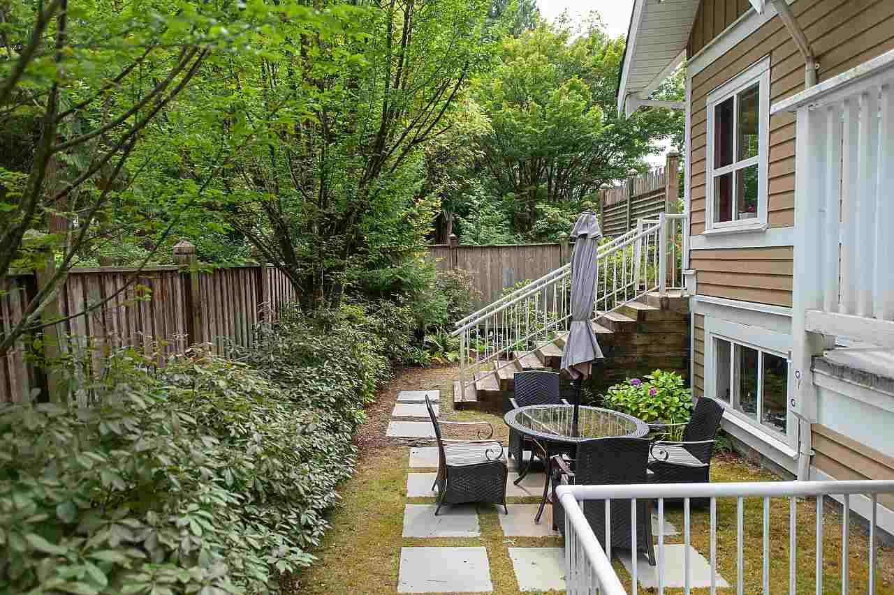 FEELS LIKE AN ENTIRE HOUSE! Perfect for down-sizers! Brody Built home in 2002. Original owner. Stunning modern craftsmanship in this bright, open concept, 3-level, +2,000 SQ/FT, 3-bdrm, 3.5 bathrm, CORNER UNIT at 'Craftman Estates.' Very quiet w/lots of privacy & sunlight. Newer oak hardwood. Large living/dining areas boast high ceilings. SS appliances in kitchen that opens to family room & beautiful over-sized outdoor patio for entertaining & gardening. Lower level w/ground entry, rec room, bdrm, full bathrm, storage, access to 2 underground side-by-side parking spots, yard & covered concrete patio. Neutral paints, built-in vacuum/sound system, gas fireplace/BBQ hookup. Prime location close to Lynn Valley Ctr, trails, schools. Open Sat Aug 24th 2-4