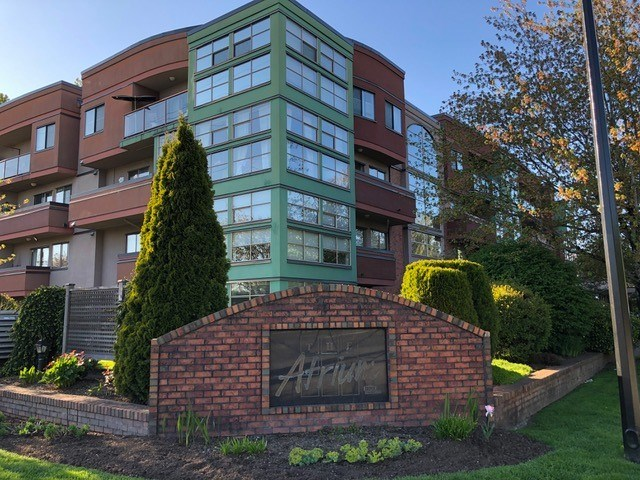 """Large 1 bedroom unit in """"The Atrium"""", a centrally  located, rental and pet friendly complex within walking distance to schools, shopping, and transportation! Great layout features spacious living room w/gas f/p, and dining area open to the kitchen. Large mbdrm w/walk-through clst and semi-ensuite. Features large south facing sundeck. Open atrium hallways to court yard. Pet friendly, rentals allowed. Suite also comes with secured underground parking and storage locker. Great walk score and located near transit, shopping, restaurants, parks, schools + Golden Ears Bridge."""