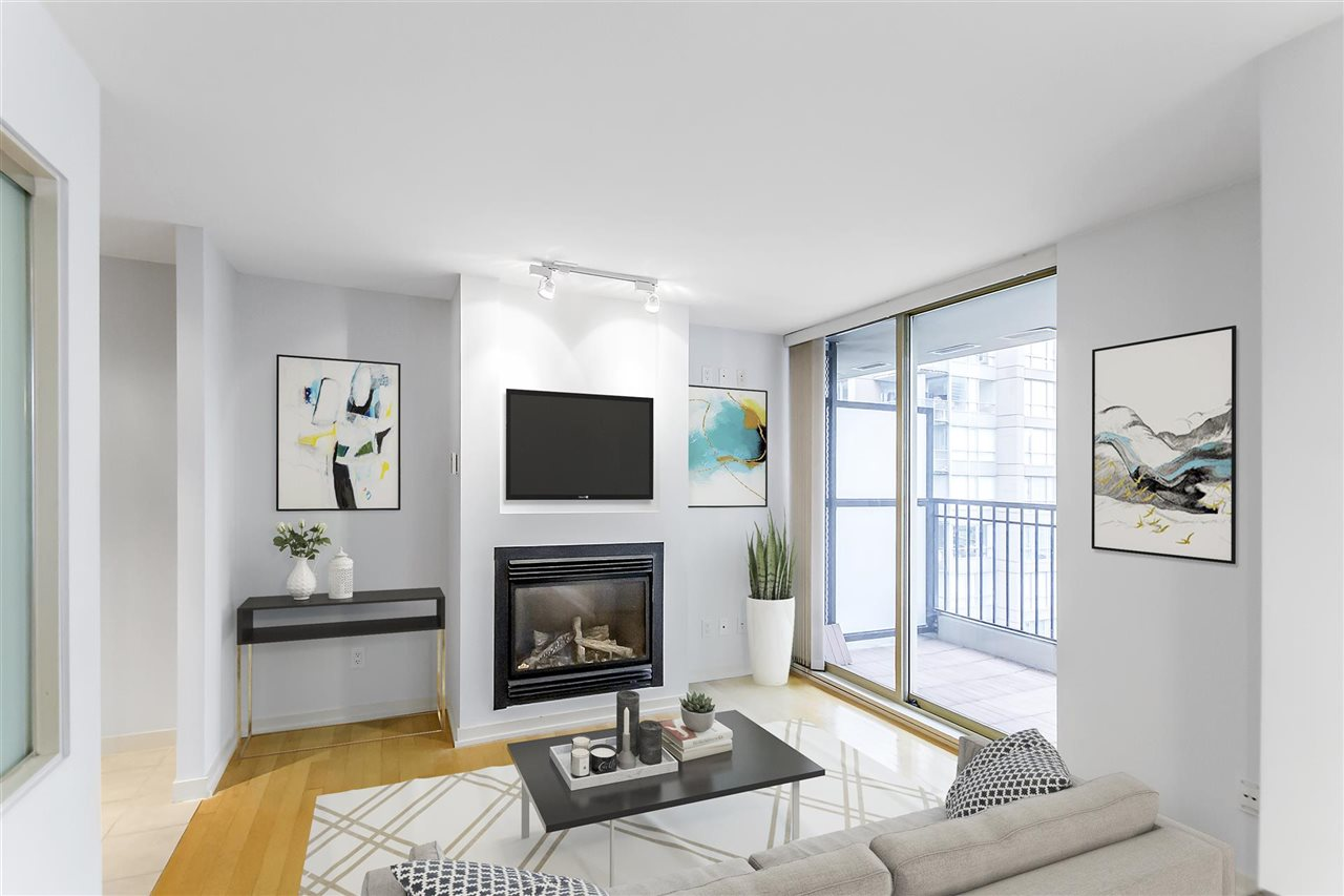 The Mondrian: Bosa quality construction located on Richards, between Smithe and Nelson. Very sought after 1 bedroom + den on quiet side of the building. Extremely functional floor plan with no wasted space, lots of natural light from large windows & northwest facing balcony.Open layout with enough kitchen space for people who enjoy cooking or entertaining. Neighbourhood has great restaurants, lounges, trendy coffee bars, shopping & parks. Includes secured parking spot (with personal bicycle rack) & storage locker. Rentals and pets OK. Strata fee includes natural gas for fireplace, oven, and stove.Amenities include well-equipped gym (including free weights, punching bag, TRX cables, cardio machines, mirrored dance floor), steam room, hot tub, pool table room, meeting room with kitchenette, two guest suites, courtyards, bicycle rooms, and visitor parking.