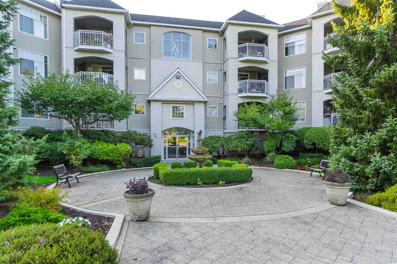 Ivy Lea! First floor but NOT GROUND LEVEL. LARGE private covered balcony off the living area perfect for barbecuing all year round. Open floor plan with bedrooms on either side of living/dining area great for sharing or guests privacy. NEW CARPET AND FRESH PAINT. New tile in kitchen and ensuite. Ensuite has heated floor! HOT WATER AND GAS FOR FIREPLACE INCLUDED IN VERY REASONABLE MAINTENANCE FEE. Kitchen features eating area and new counter tops, all stainless appliances & instant hot water! Building has been repiped, Hallways redone 5 years ago. Roof is 10. Walk to everything! No need for a car here. Strata has some extra parking spots for rental. Short waitlist. Pets welcome. One dog or cat up to 12""