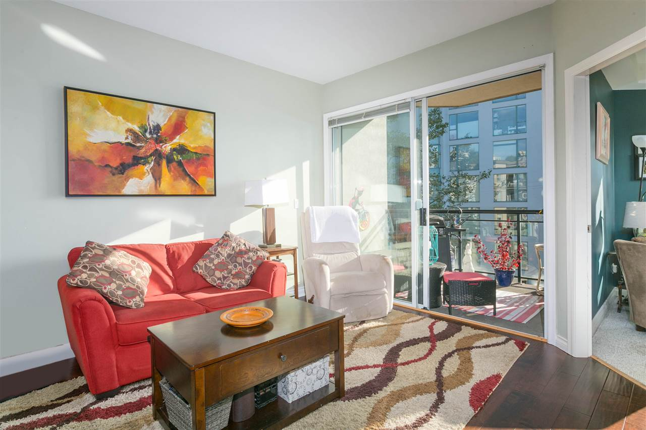 This bright two-bedroom suite is move in ready! Don?t be fooled by the address as this fantastic property is located on the quiet south side of the building taking full advantage of the southern exposure and city and water views. You will love the open floor plan that is highlighted by gleaming hardwood floors throughout the living and dining areas. Kitchen includes eating bar, Corian counters and modern stainless appliances.  This home is perfect for all seasons offering the warmth of in-floor radiant heat and a cozy gas fireplace for the cool weather and a sunny balcony to entertain or enjoy the view in the summer months. At present the building offers high speed internet and digital cable included in the maintenance fee. Bring your pet as this building is pet friendly! One parking and one storage included. Located in the heart of trendy Lower Lonsdale, this well-maintained building is steps to fantastic restaurants, shopping, the Lonsdale Quay, transit and more! Call today to book your private viewing!