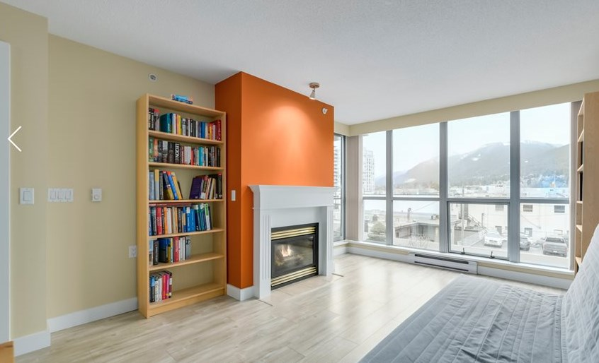 "Beautiful views of the North Shore Mountains in this recently updated, bright & spacious 610 sqft, 1 bedroom, open concept floor plan home at ""The Piermont"" in the very heart of Central Lonsdale. Newer solid flooring throughout. Kitchen w/granite tops & newer appliances. Floor to ceiling windows. Large living & dining room areas for entertaining. Walk-through closet in bedroom. *Gas fireplace, neutral color paints, baseboards, modern lighting. Covered balcony with view & private outlook. Concrete building. Prime location central & walking distance to shopping, transit, restaurants, cafes, rec centre & Lions Gate hospital. 1 underground parking/1 storage locker. Pet friendly/No rentals."