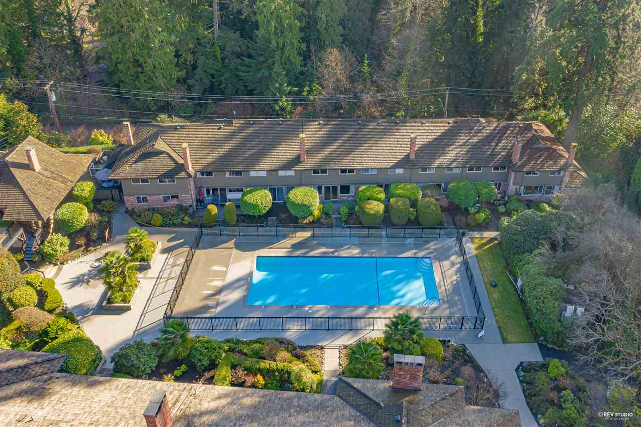 Welcome to Spuraway Gardens, West Vancouver's hidden gem. One of the few unique units located directly on the resort-like pool area, right out your back door! This spacious 1,583 sq ft. 3 bedroom, 3 bathroom  townhome has been completely renovated with exceptional quality, featuring: high-end quartz and marble, hickory hardwood floors, a designer colour palette, sound-proofing, new in-suite laundry, gourmet kitchen updated with S/S appliances, & new cabinets, a bright home office, plus a fabulous private patio surrounded by lush bushes and plants & much more. Enjoy a beautiful, private setting of mature manicured gardens, gorgeous lawns, Historic Log clubhouse and more. This is truly one of the best value townhouses in West Vancouver! Walking distance to everything.