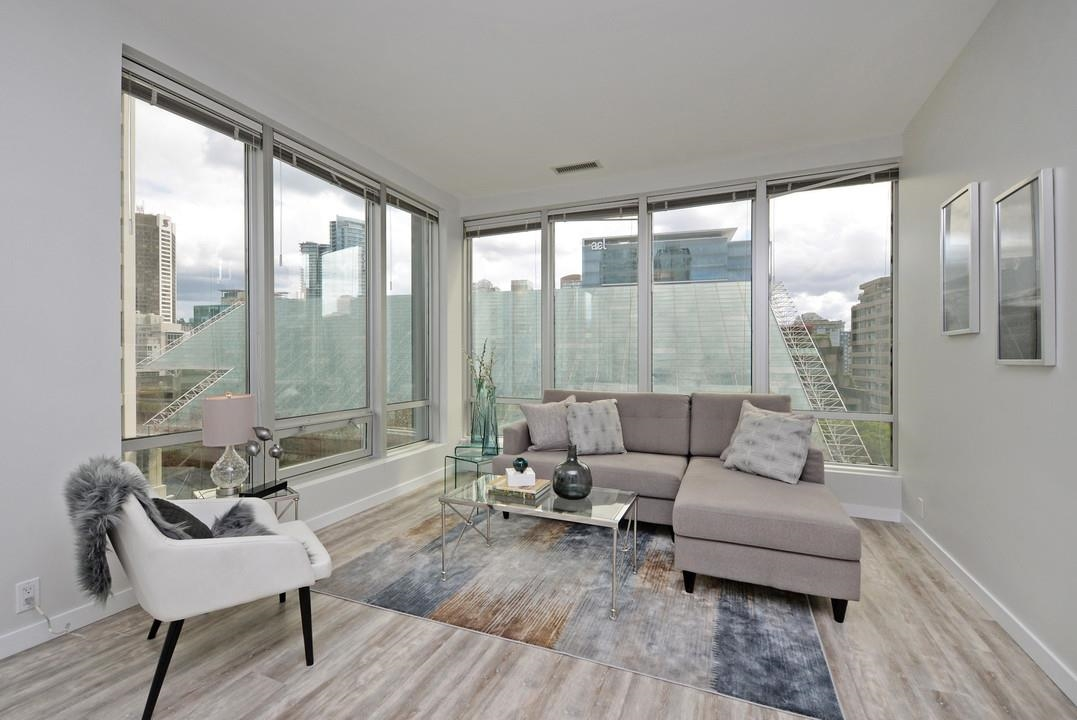 This chic, fully updated 1 bedroom corner suite at the iconic Electra building in the heart of downtown Vancouver is now available. Rarely offered, this bright and spacious home-sized at 614 sq ft offers an easterly exposure, 9 ft ceilings, & floor to ceiling windows facing a quiet, treed outlook towards the iconic arthur erickson glass-roofed courthouse on Hornby, and is well sheltered from street noise. Recent stylish interior updates including: laminate flooring, stainless steel appliances, stone countertops, cabinet doors, & bathroom. Convenient large storage locker & free shared laundry on the same floor & A/C & Heat are included in strata fee! Situated in the hub of Downtown's financial, entertainment and shopping district, this unparalleled location boasts a 100 Walk-score, just steps to Robson St., YMCA and skytrain. Guests suites,  fitness club, saunas, showers, gym, lockers, billiards, table tennis, theatre, party room w full kitchen & bbq. Don't delay, book your appt to view today.