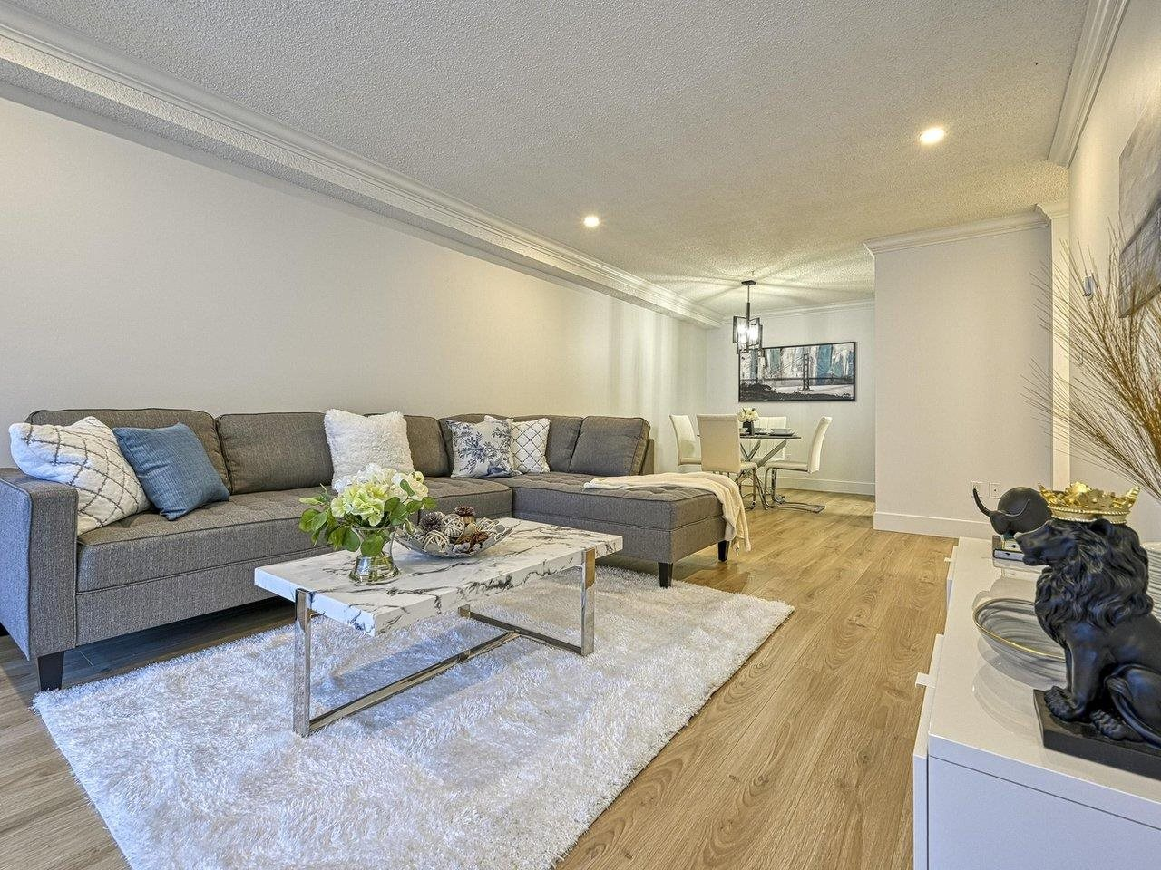 MASSIVE PRIVATE BACKYARD & COMPLETELY RENOVATED!! MOVE-IN ready with amazing renovations throughout. This functional and spacious 2 bedroom floor plan has everything you could ask for! BRAND NEW laminate flooring, luxurious tiles, crown moldings, baseboards, light fixtures and fresh paint! Enjoy a gleaming kitchen with BRAND NEW custom shaker cabinetry, elegant quartz countertops, tile backsplash, stainless steel appliances and tons of extra deep storage & counter space. BONUS: massive ground floor patio with PRIVATE GATE/ACCESS, enjoy the sunshine with your own deck, gardening space and convenient access in and out, perfect for entertaining! This well managed complex boasts amazing amenities, indoor & outdoor pool, hot tub, sauna , recreation/lounge area, and tons of green space.