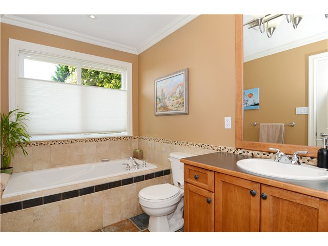 Ensuite bathroom with shower and bathtub