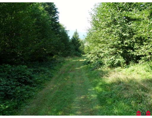 76 acres of rural private treed property. Possible river views from benches.