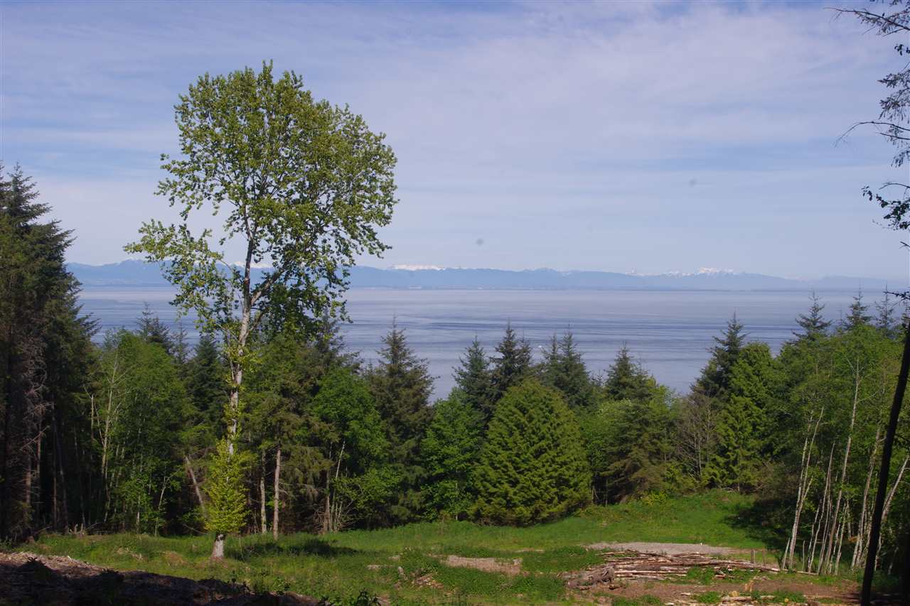 View across the Strait of Georgia from the Vancouver coast line to the Sunshine coast. 4.95 acre treed lot in Panorama Estates with view and potential building site cleared. Lot has driveway roughed in from Panorama Lane (a private access easement). A 25 gallon per minute well. RR zoning allows for the building of a home and cottage. Panorama Estates borders Bodega Ridge Park.