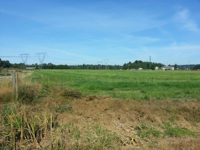 High Profile corner of 176th (Pacific Hwy) and 8th Ave, 17.08 Acre parcel with A1 / ALR status. Note Farm taxes. Great future potential.