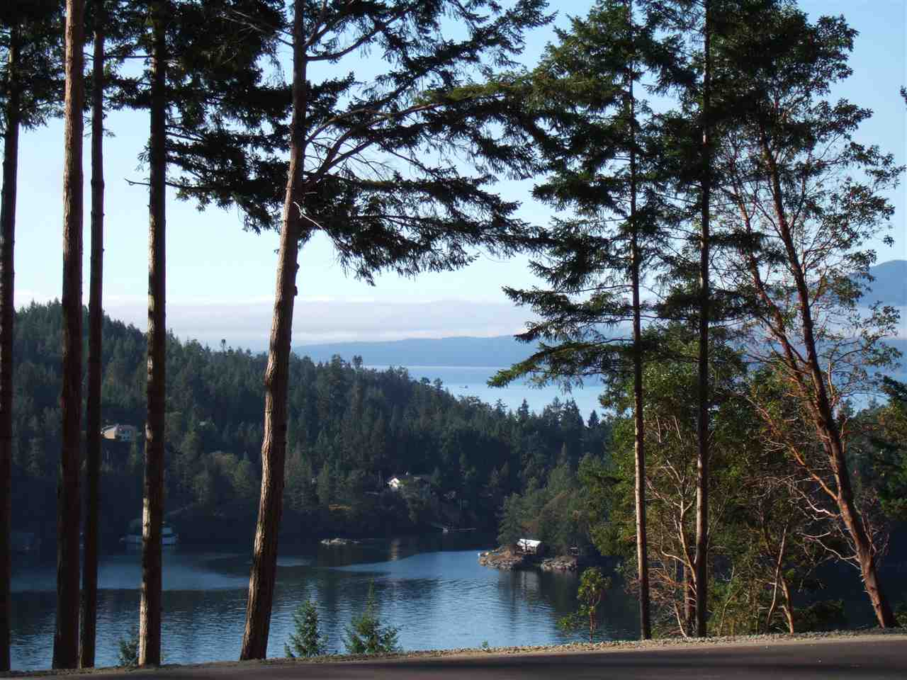 Oceanfront Property in Exclusive Pender Harbour Landing Development Freehold, non-strata 1.48 acre Estate Lot boasts awesome Harbour & Strait views w/South Exposure & is fully serviced underground.