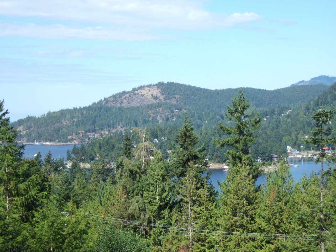 Awesome outlook West from the entrance of Pender Harbour to Malaspina Strait from this 1/2 Acre building lot in Central Madeira Park. Freehold (fee simple) ownership (no strata fee). Plenty of recreational boating, hiking, freshwater lakes & golfing all nearby. Driveway + Build Site in place.