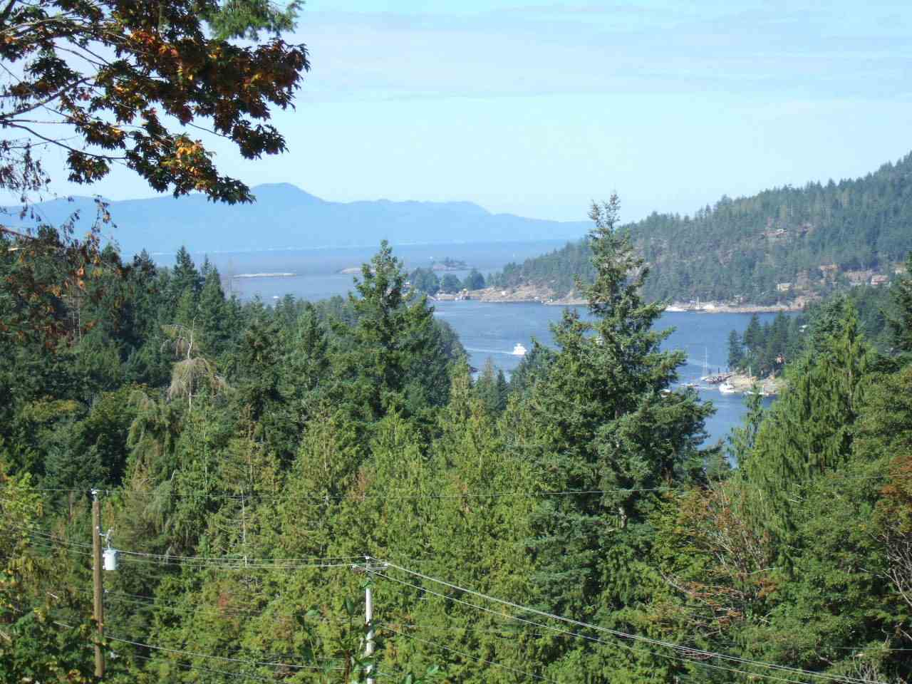 WESTERLY VIEWS of Pender Harbour & Straits - Residential Building LOT .54 acre. Located in the heart of Madeira Park Village. Minutes to shopping & amenities, including moorage & public boat ramp. Excellent recreation choices include hiking, boating/fishing, golfing. Freehold (fee simple) title means no Strata Fees or Rules. GST applicable on Purchase Price.