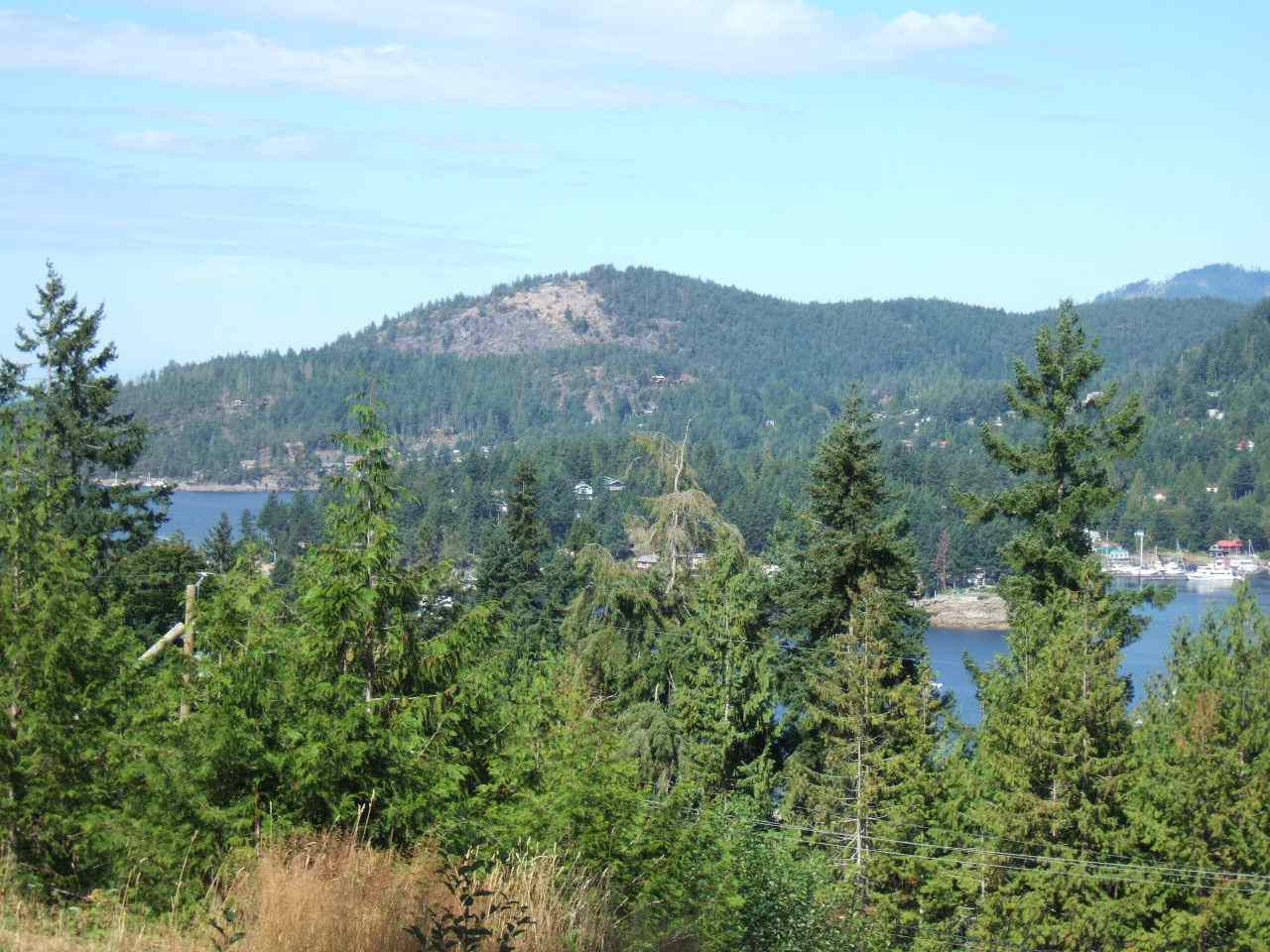 Residential Building Lot - Cecil Hill Road Development in the Heart of Madeira Park (Pender Harbour Area). Freehold - fee simple ownership (no strata fees or rules!). Paved access road with hydro/water to the lot lines & building sites partially prepped. Lot 16 has a peek of ocean view into Pender Harbour. GST applies to Purchase Price.