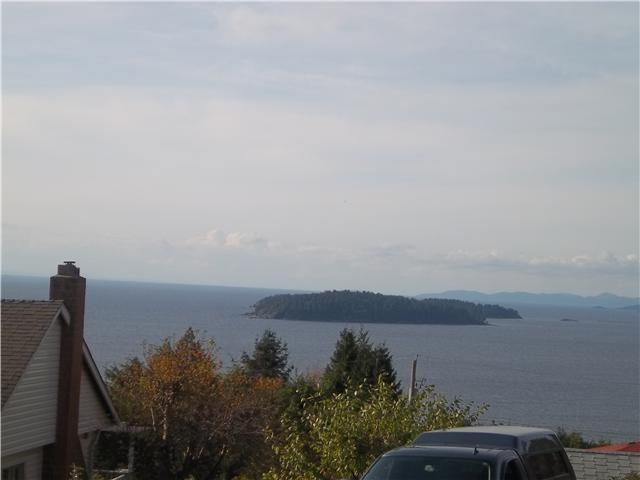 This spectacular 5 acre ocean view development parcel is extremely well positioned in the highly desired area of Selma Park between Davis Bay and Sechelt on the Sunshine Coast. This location is 5 minutes before Sechelt where all the amenities are including groceries, banks, drug stores and the hospital for the Sunshine Coast. The exposure is excellent with the street being West Facing for enjoyable sunsets. Services include hydro, water, cable to the edge of the development parcel. The current application is with the District of Sechelt for an 18 lot subdivision each lot ranging in size from 1002 sq. m. or keep as your own trophy acreage for a prime acreage site for 2 gorgeous homes with current R1 zoning.