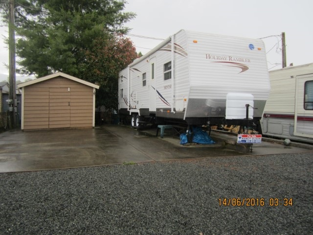 Lovely inside lot on a quiet street, Happy Hour Lane: can enjoy the fun at Hatzic Lake year round. This lovely lot includes the newer 30 foot trailer, just pack and up and load up sleeps 8 easy!. has a 6 x 8 shed with electricity for storage, concrete pad and retaining all with over $12000.00 spent on that. Stop fighting for camp sites. The Everglades Resort on Hatzic Lake is a gated community with clubhouse, common areas, parks, playground and boat launch. Lots of fun to be had. Close to Sandpiper Golf Course and many other activities. Only 1 hour and 15 minutes from Vancouver. Only fee of $1467.00 including taxes per year!!! Get ready for summer fun.