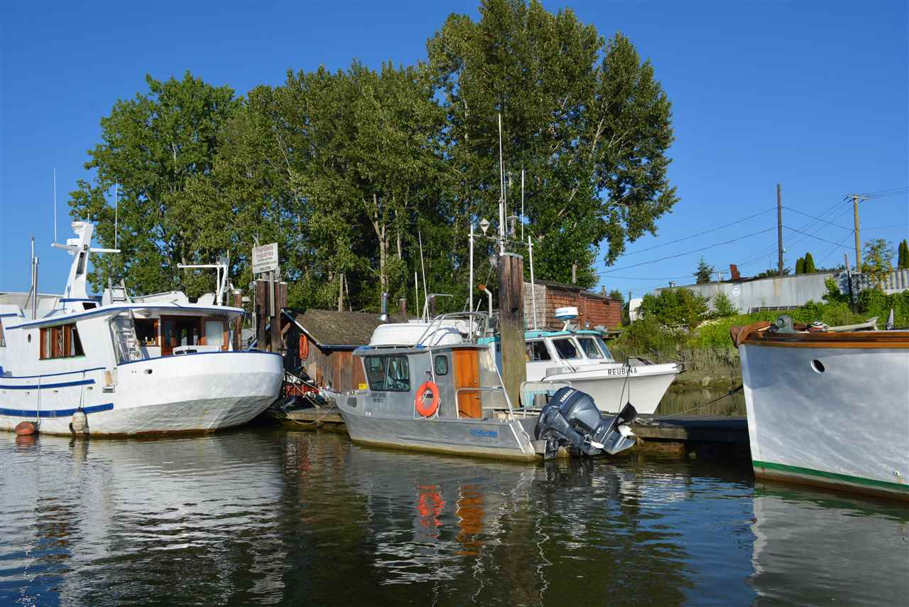 Opportunity knocks on one of the last remaining expansive lots in Ladner including water lot lease for 200 feet of river. Currently a private marina with approximate income of $28000 per annum.  This is located a 5 minute walk from the heart of Ladner. Must be SOLD WITH 4661 River Rd.  Please do not disturb tenants.