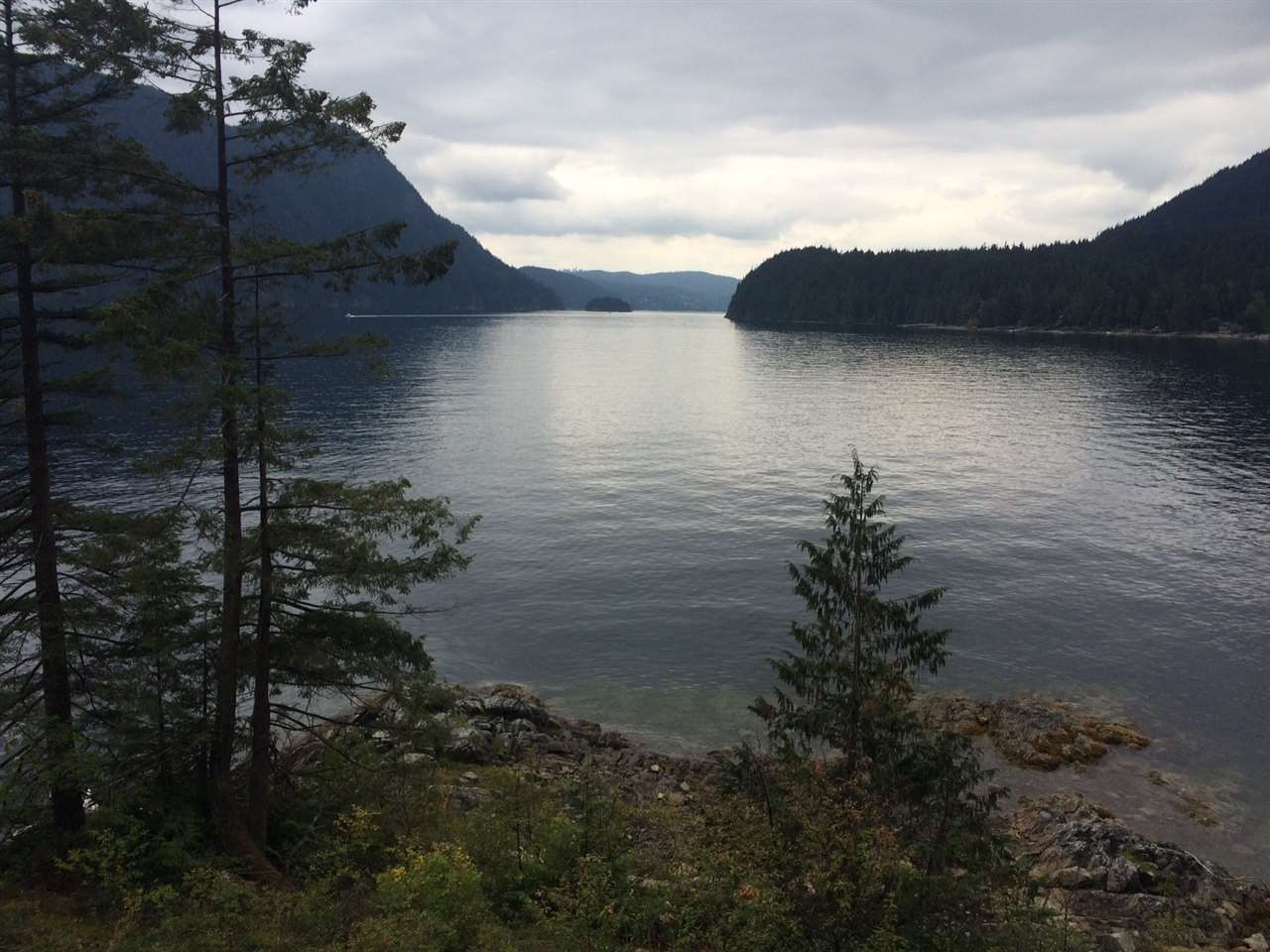 Rare freehold waterfront lot at Best Point in Indian Arm. Lot 13 is located on the west side of the arm in North Vancouver and is located in a rare Southern exposed position of the Northshore side of The Arm. It's one of a 14 lot development that borders BC Parks. Approximately 1/3 of an acre with 66' waterfront with a small protected bay with south facing views. Located 15 minutes close to Deep Cove via boat access only.
