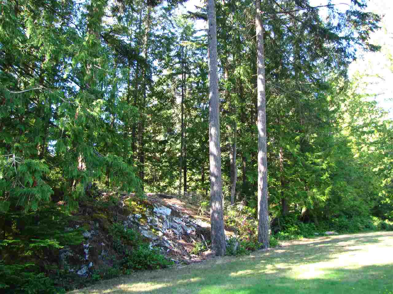 Surrounded by parkland, quiet walking trails, and stunning viewpoints, these Evergreen Lane lots are each unique and budding with potential. Only a handful of lots remain for sale at Evergreen, with Lot 14 offering a unique opportunity for a private, forested home overlooking Aaron's Field. 1.52 ac., GST and building scheme applicable.