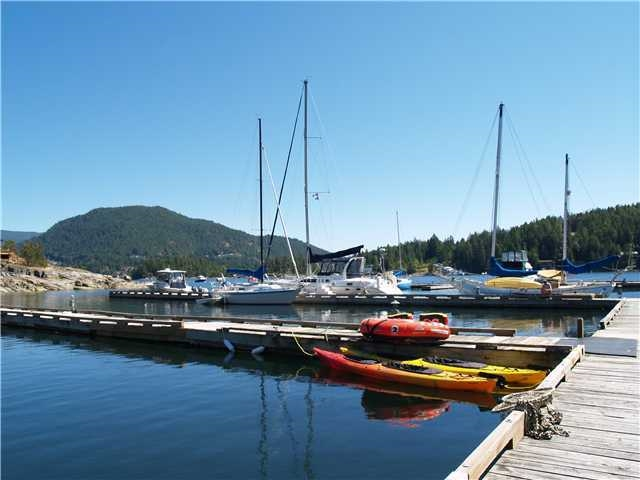 This 1/4 acre waterfront lot looks into Duncan Bay, in Pender Harbour, the mecca for ocean going vessels. You can lease a boat slip in Farrington Cove marina for most lengths of boat/yacht, if you purchase within this subdivision,. The roads are paved throughout and there are underground services close to the lots. There is a community sewer so extremely user friendly. The private tennis court is available on a first come first served basis for Farrington Cove property owners. Bare land strata fee is $80 per month covers underground service, tennis court, road & water feature maintenance. Call listing agent for minimum building requirements - no requirement as to start up time. Hold as an investment until you are ready to build and retire.