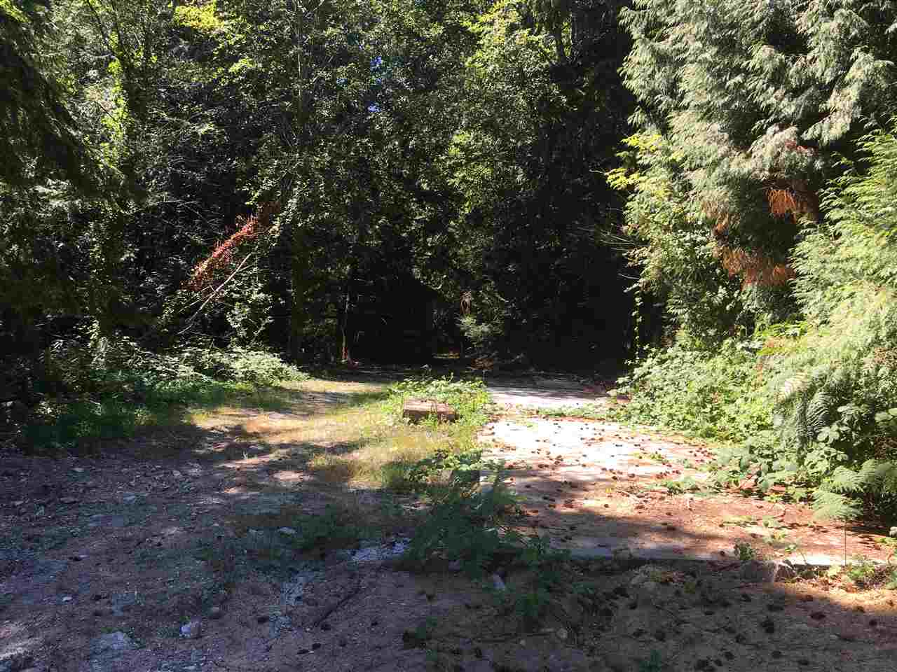 Close to the beach and very private this .68 acre lot is just waiting for your ideas! Flat building lot is zoned for a single home and 592 sq.ft. cottage. Septic system is in but would have to be inspected. Electricity, gas and water all at lot line. It's your time to live in Roberts Creek! Call listing agent for additional information.