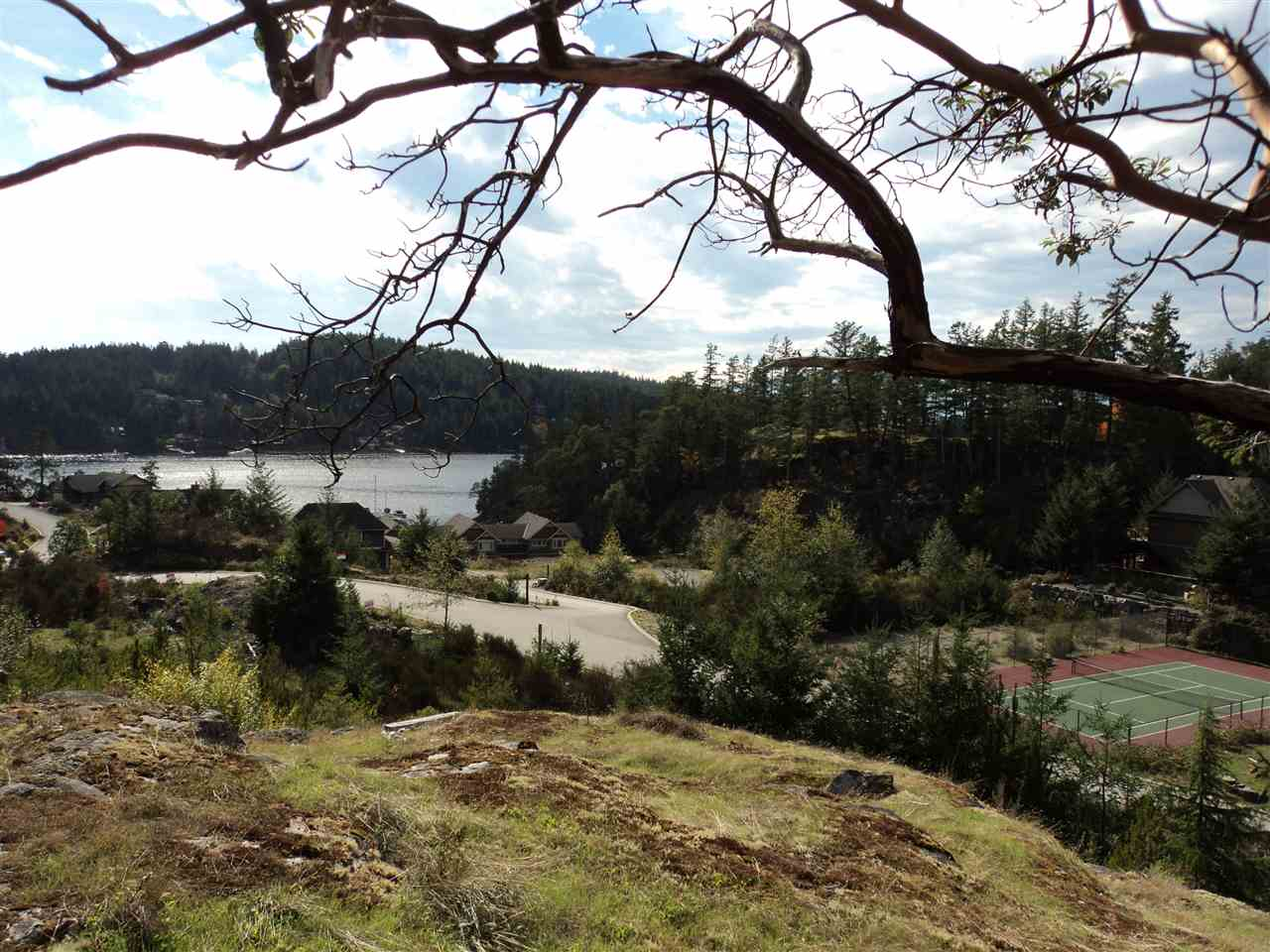 Sunny, private view lot with highest elevation in Farrington Cove. All serviced and ready to build. Waterfront development offers private marina and tennis court, building scheme to preserve values. Call Realtor for personal tour.