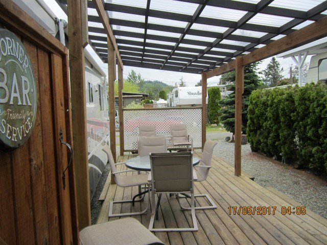 AN AMAZING INSIDE User Area LOT SET UP FOR THIS SUMMER AT THE EVERGLADES RESORT - Waterfront steps away. Totally set up for entertaining a covered deck and sitting area with a private out side room with sinks, bar and counters and bonus washroom and shower set up. Great for family and friends visiting. A total entertaining lot great privacy and parking. A must see a perfect get-a-way this summer. Open year round, gated, clubhouse and parks and private boat launch. Close to boat launch and beside the park. 1 hr and a bit from Vancouver, why reserve spots: own your own! Call today!