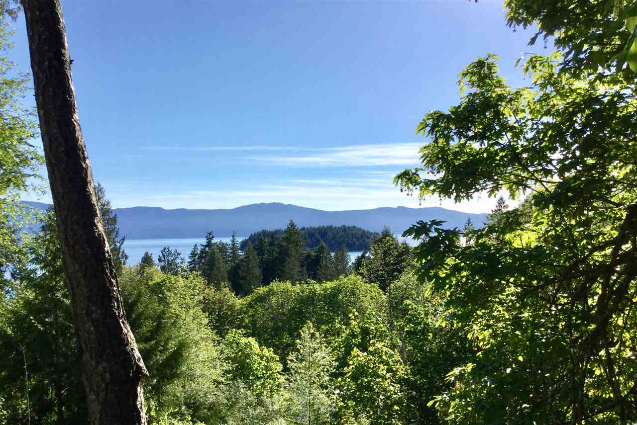 Beautiful west facing sunny ocean view, tiered level .5 acre lot with trail steps away to the ocean. Pender Harbour Landing lots have underground services to lot line with paved road access. Enjoy the higher end neighborhood with mature trees edging this lot.