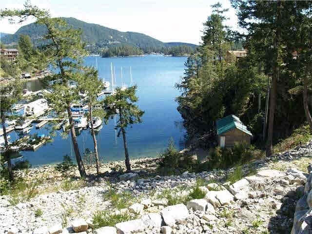 """Waterfront lot in """"Farrington Cove"""". A beautiful waterfront development in Sunny Pender Harbour which boasts an option to lease in the marina facilities, underground services including a community septic treatment plant. Kayaking, hiking and outdoor activities at your doorstep. Bring your yacht right up to the dock - able to accommodate very large yachts. Each lot owner has the right to use the tennis court and to enjoy the community water feature.You can build when you are ready or hold as an investment. Call listing agent today to view."""