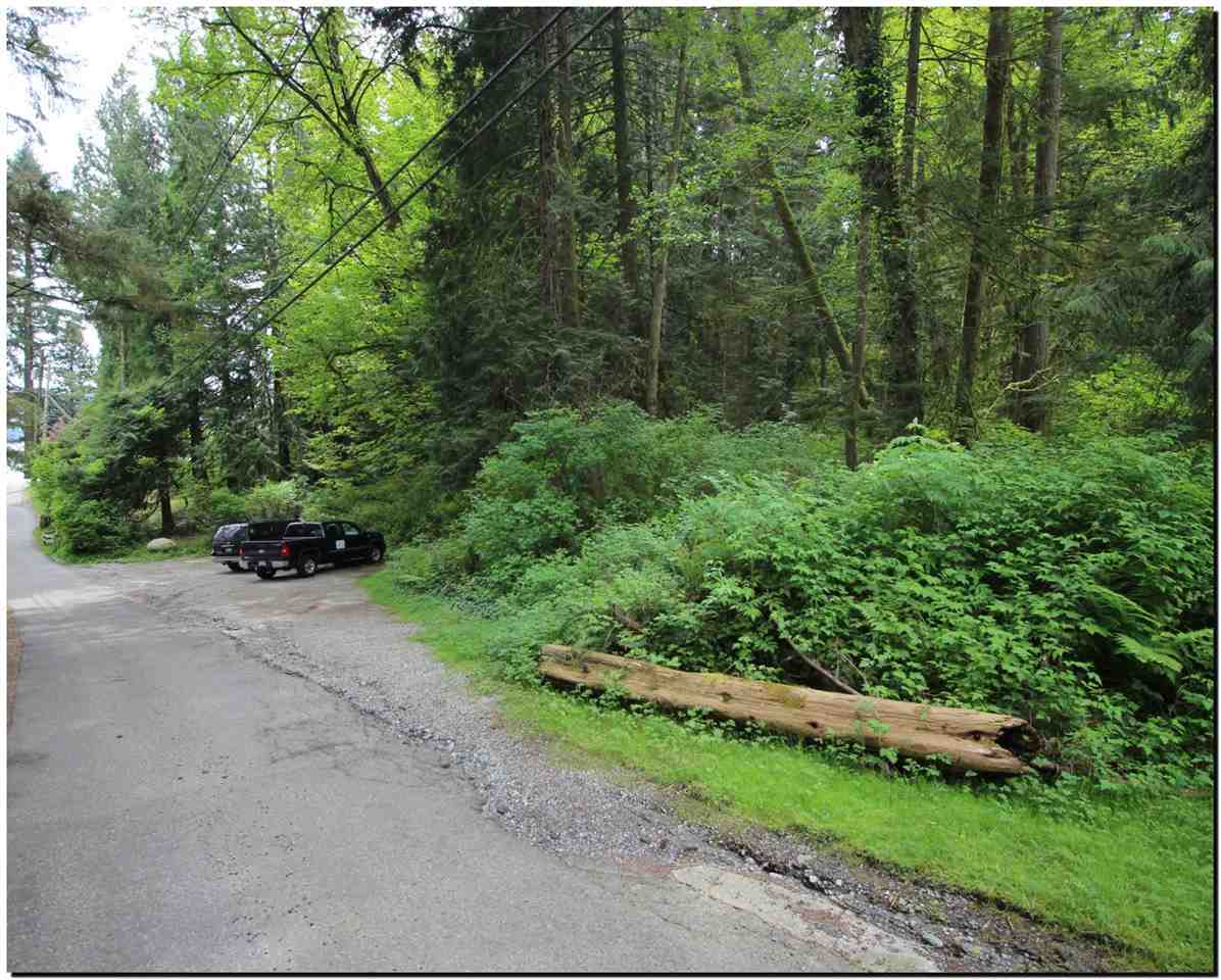 Located on the corner of Firelane 4, this gorgeous almost 1 acre building lot provides exceptional mountain and water view potential! This property is located directly behind water access to the beach perfect for kayaking, swimming etc. Create your DREAM HOME here is this private, pristine and friendly community all 7 minutes to Parkgate Community Center! Septic system in, municipal water & power at the lot line.