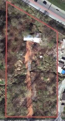 HIGH EXPOSURE from Hwy 1 and from 56 Ave. Private & level 2.29 acres. City water and Gas at the street. Long drive way to old workshop. 220 power, cable and phone on the property. Quick Hwy 1 access. Zoning allows for 3 trucks, a house and a mobile home. Minutes to town. Dont miss out - Call now.
