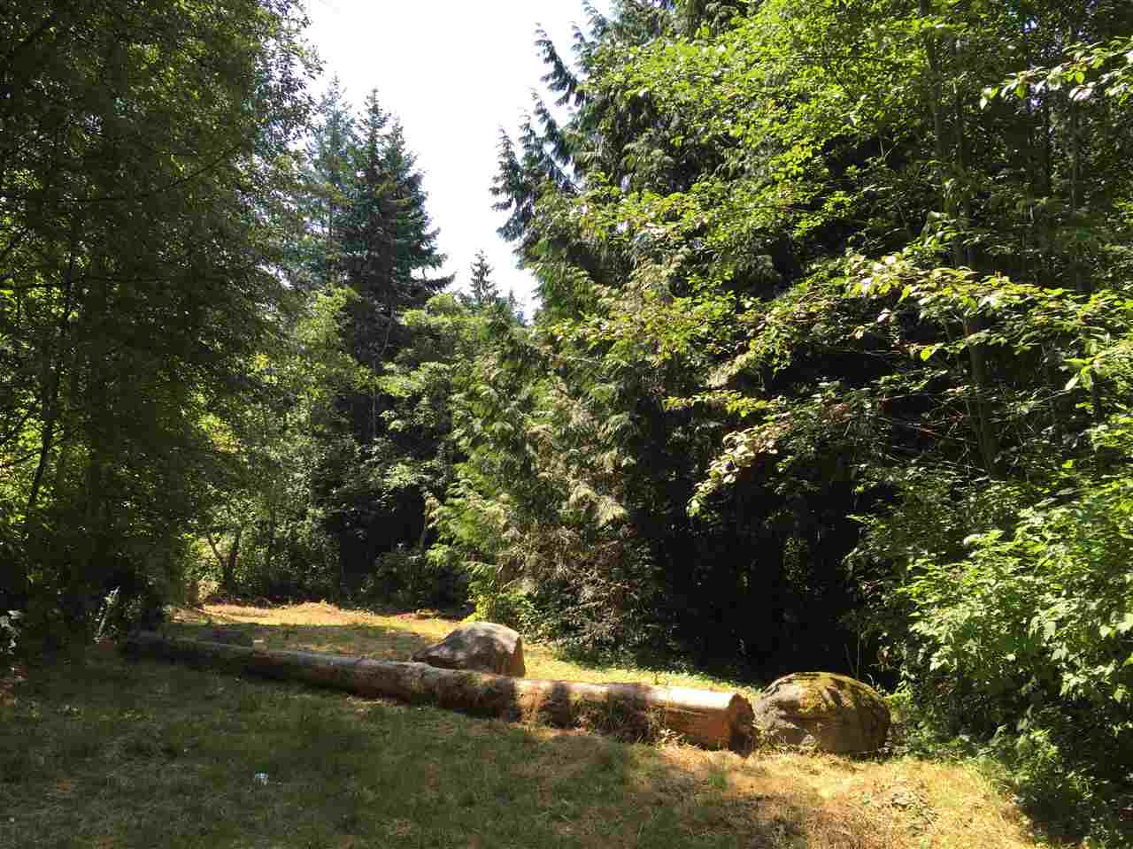 2.1 acres in Gibsons! Build your dream home or hold for investment. This is a lovely treed property bordering End Creek Park and kitty corner to Ocean Park. At the bottom of the property you will find a trail that leads you on a 5 minute walk to the beach. Please call listing realtor for an information package.