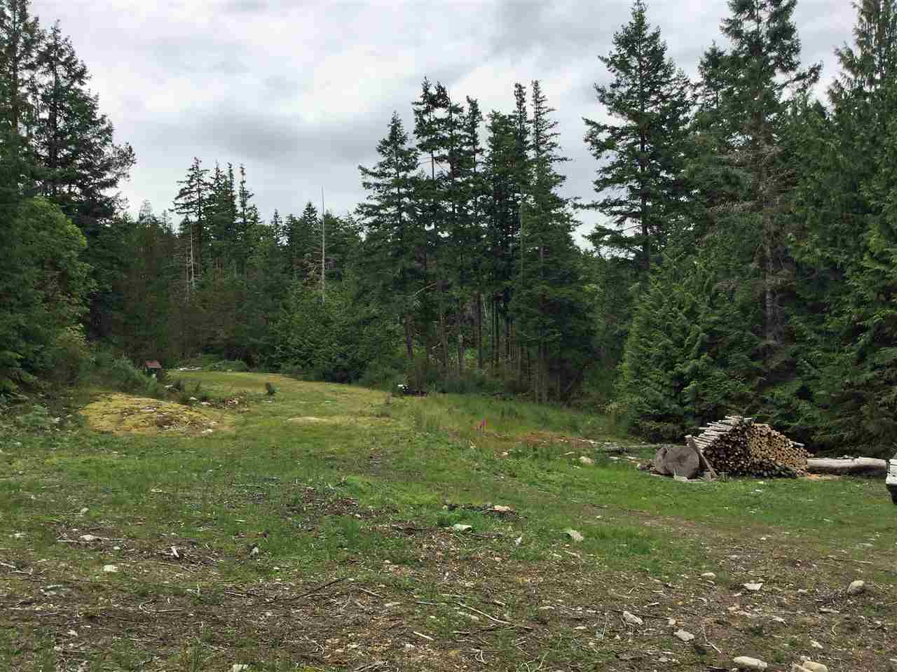 Incredible Acreage (4.47 Acres) Purchase Opportunity! Very Private Just steps to Moorage in Secret Cove. Driveway is cleared and much of property is groomed into meadow with machine groomed trails throughout the forested portions to a choice of building locations with view potential. 2nd legal driveway off Sunshine Coast Hwy. is currently under construction. Many beautiful Arbutus Trees throughout this property. Drilled well on site, with entitlement to Municipal Water. Two dwellings permitted - super group or family purchase opportunity.