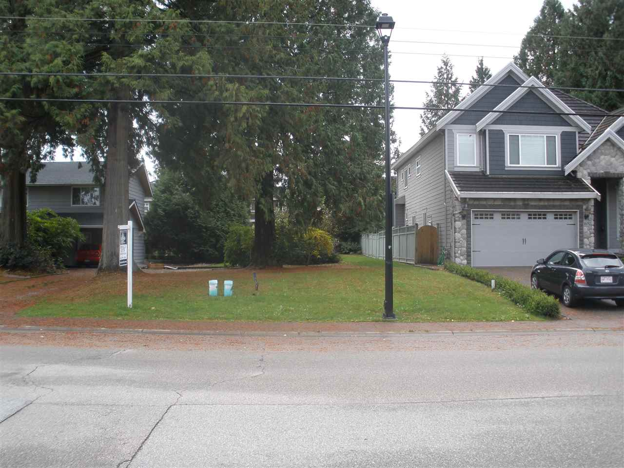 Wowsers! Extremely rare  level building Lot, extra deep south facing rear yard. Ready for building permit application... 8016 Sq Foot, front facing north, fully serviced and across from a peaceful ,quiet park in prestigious Fraser Heights. Lot will accommodate a three level home. Fifty feet frontage.Very close to schools, shopping and parks. There may be nice mountain views from second story of a new home? Existing trees are being removed.  Compliance Deposit is $22,500. For plan review & plan approval, Design Consultant is Tynan Consulting Ltd. There is an ESC approval fee of $500.00 Purchaser.