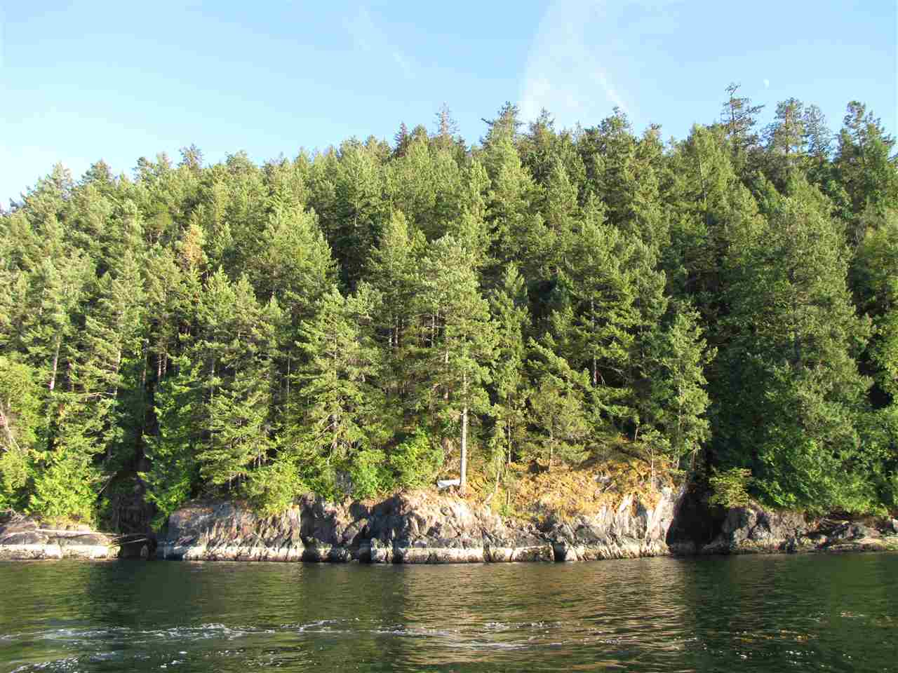 Off-the-grid waterfront building lot on Bowen Island. This 0.843 acre lot features a stunning view facing Gambier Island and the Sea-to-Sky country beyond. Flat benches for potential building sites, and lots of privacy. Rare opportunity to build your own island getaway. No road access.