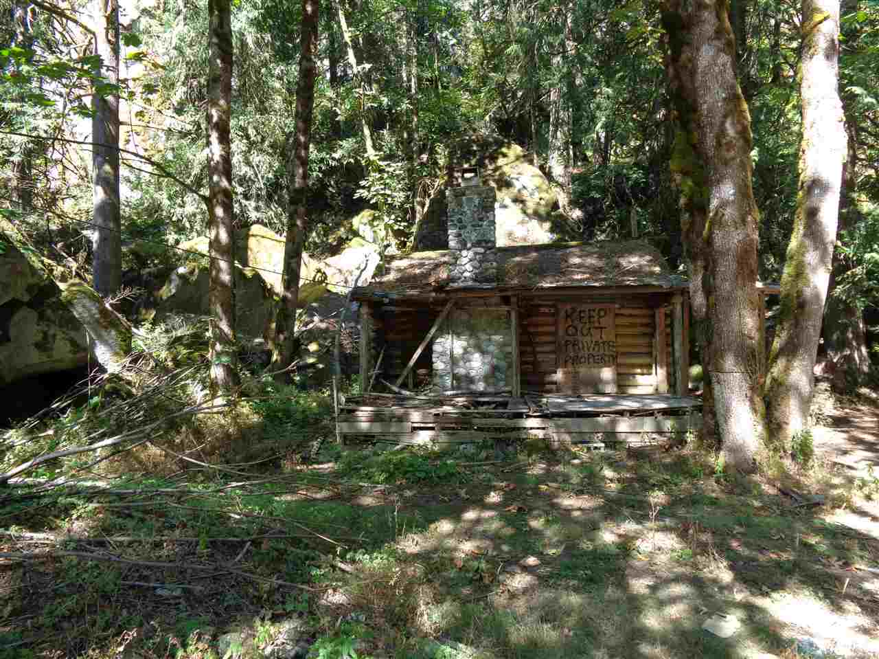 Water front property on Silverhope Creek! 8.77 acres, flat usable portion is approx. 1/2 acre. 2 older log cabins on the property - Bring your ideas! The seller has an active water licence.