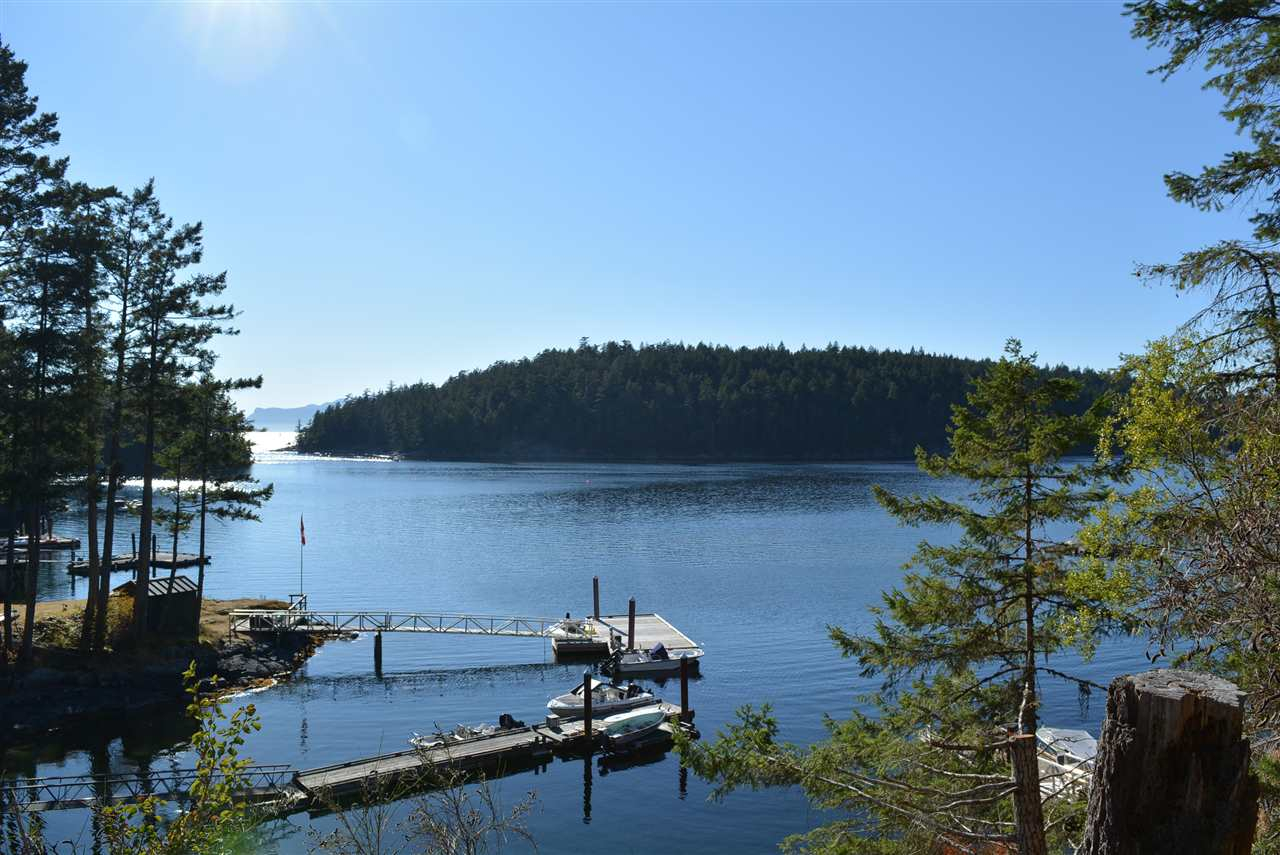 Enjoy the majestic sunsets Halfmoon Bay is known for from this West facing waterfront lot in Secret Cove .Terraced two-level granite building envelope is awaiting your custom home that will provide ever-changing views towards Thormanby Island and the mouth of Secret Cove. This area offers close access to boating, fishing, crabbing, some of the most spectacular hiking trails and is located near Secret Cove Marine Park.  This property offers true privacy yet only 20 minutes to Sechelt for restaurants, shopping and all amenities you could ever need. This could make the ideal get-a-way from the city or a full time residence to create a legacy to pass down for generations. Call us for a full package.