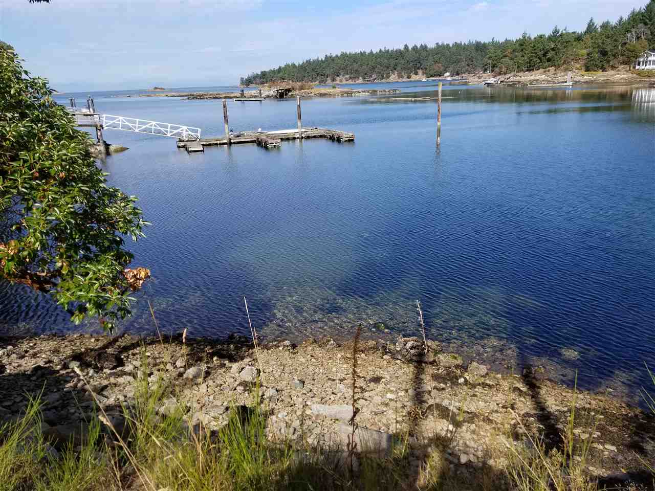 Lovely Whaler Bay waterfront property of 0.37 acres enjoying panoramic views of the bay and across the Strait of Georgia to the Coast Range mountains. Over 88 feet of accessible shoreline. On community water system. Amenities nearby. Walking distance to the Sturdies Bay ferry terminal, shops and eateries. Tie up your boat at the government dock in the same bay. Property has been cleared and is ready for your dream home on beautiful Galiano Island.