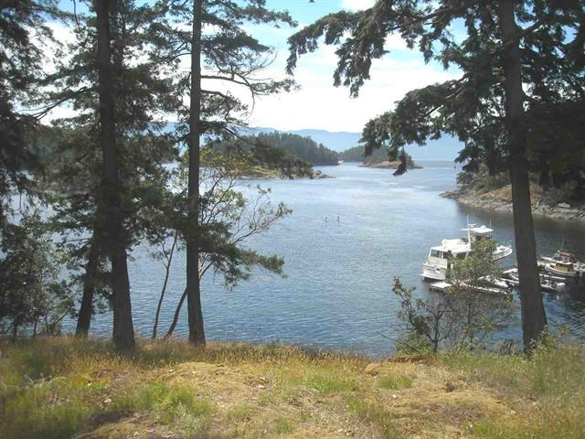 Easy to build south west facing Waterfront lot, close to the community dock in Whittakers a special waterfront community. This is one of BC's finest waterfront communities offering private, protected deep water moorage. This 60 feet of Waterfront is situated on a large, forested acreage called 'Whittakers' and has maintained a natural West Coast feel with Arbutus trees, mossy rock out-croppings & spectacular ocean views.
