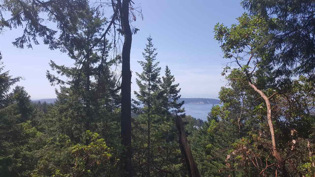 Gorgeous expansive views of The Georgia Straight from this 4.25 acre parcel of land situated above Secret Cove in Halfmoon Bay. Woodbay Heights offers estate lots in a private community setting. The Sunshine Coast is full of recreational activities such as boating, fishing, kayaking, hiking and golf courses as well as marinas just minutes away. NO GST!!