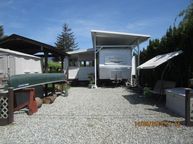 The Everglades Resort at Hatzic Lake - Gate lake community open year round appx. 1 hour from Vancouver. (no year round living). Waterfront UA on a channel with it's own dock, canoe and paddle boat. This lovely 2006 trailer with huge slide out and aluminum cover that sleeps 8 people, and has a extra bonus room built on for year round entertaining. Set up for year round use. Very nicely done up, private, fenced, practical and on a huge 30 x 75 lot. Storage shed, New outside covered area, new paint outside. Too much to list. It doesn't get any better than this for the price, call for more information. Just pack your bags and you are good to go. Own your very own get a way on the lake!