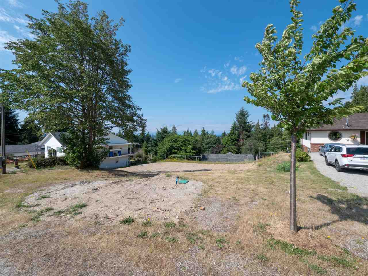 Check out this Davis Bay VIEW LOT located on a quiet street in an established neighbourhood. Within walking distance to Davis Bay esplanade, local shops, cafes and only minutes away from endless recreation. Lot is cleared and ready for your building plans with a new septic system recently installed. Call your agent today to check out the possibilities.
