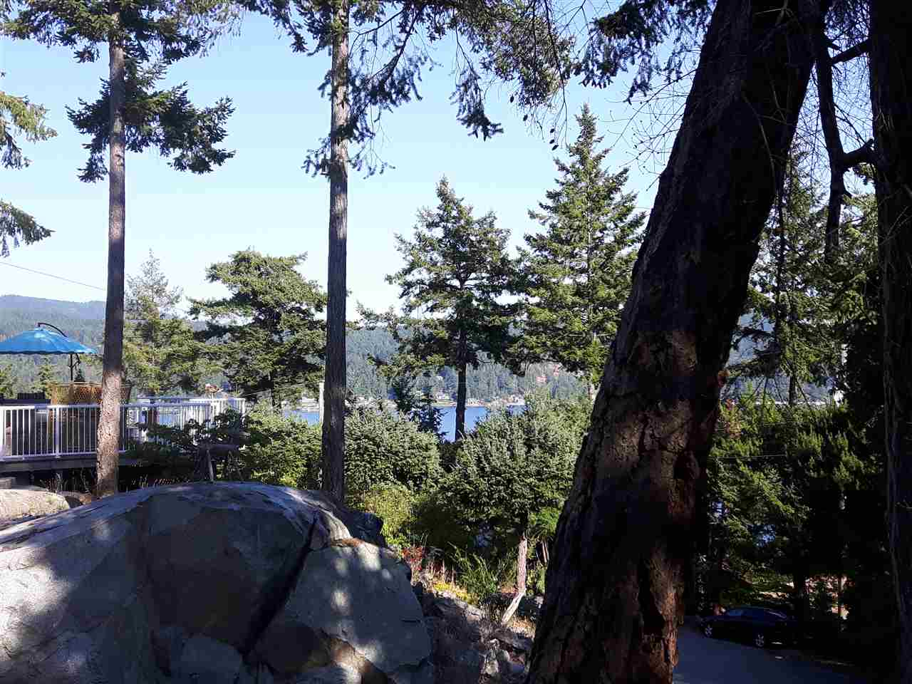 Desirable elevated ocean view lot on upscale Truman Rd. with community sewer available and services at road. Very close to Crab Rd beach access with mini park. Also easy access 3 minutes away to famous Smugglers Cove Marine Park. Lot needs a driveway.