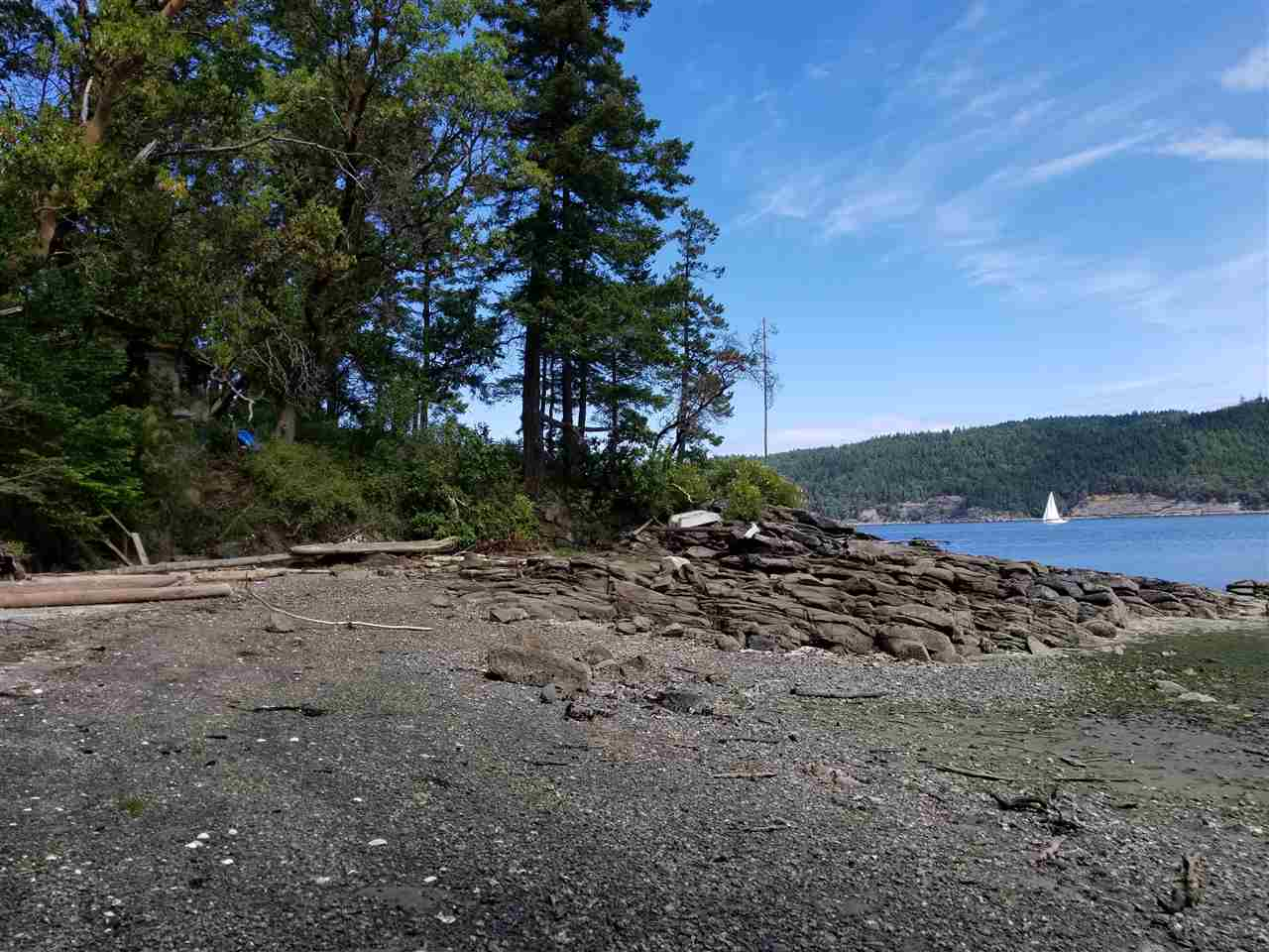 Water building lot with over 117 feet of Sandy Beach on Wise Island. Located in a protected bay that dries out at low tide, a wonderful playground for kids of all ages. 0.35 acre of land, fully treed and usable land. It is connected to a community water system. Wise Island is located between Galiano and Salt Spring Island. It is easily accessible from protected Montague Harbour on Galiano or from Ganges on Salt Spring Island. Bring your cottage plans and build your dream cottage on one of the few buildings lots left on the island. Property with cabin on a point of land to the west is located adjacent to subject property and is for sale by same family. Acquire both properties for yourself or buy with friends.