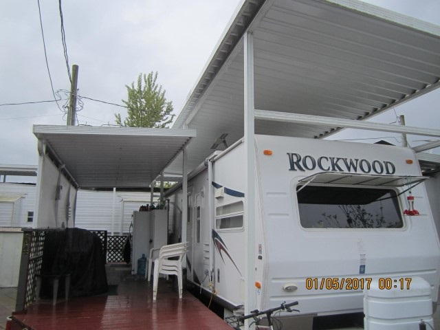 HATZIC LAKE - EVERGLADES RESORT. Nice lovely spot at the lake, very private with decks and patio nicely done with paving stones. Includes a Rockwood trailer, 37 ft unit covered with an amazing aluminium awning for rain or shine. Come and enjoy the lake this summer. Across from the park. Gated resort has it's own boat launch, parks, clubhouse and swimming area. Approximately just over an hour from Vancouver - why book a site? Own your own getaway!